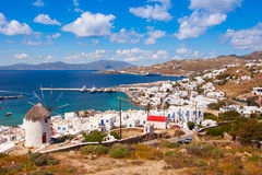 The famous windmill above the town of Mykonos in Greece against Royalty Free Stock Photos