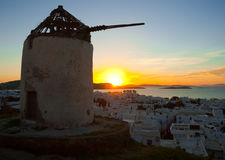 The famous windmill on Mykonos at sunset Royalty Free Stock Images
