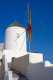 Famous windmill in Oia town, Santorini, Greece Stock Images