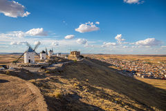 Famous windmills in Consuegra at sunset, province of Toledo, Cas Stock Images