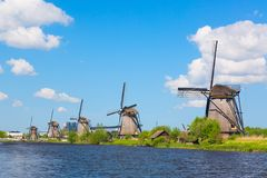 Famous windmills in Kinderdijk village in Holland. Colorful spring landscape in Netherlands, Europe. UNESCO World Heritage and fam. Ous tourist site stock photography