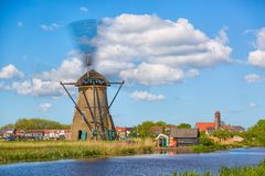 Famous windmills in Kinderdijk village in Holland. Spinning windwill. Colorful spring landscape in Netherlands, Europe. UNESCO Wor. Famous windmills in stock image