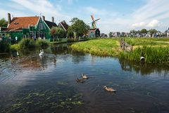 Windmills by the river, Netherlands. Famous Windmills by the river in Zaanse Schans, Netherlands. Some ducks in the river too Stock Photography