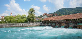 Famous wooden sluice bridge over aare river, thun city, switzerl Royalty Free Stock Images