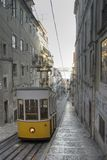 Famous yellow Lisbon tram. Going up the street Royalty Free Stock Photo