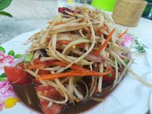 Famouse menu in Thailand streefood that Papaya spicy Salad with fresh shrimp or Fermented fish or Blue. Papaya Salad with fresh shrimp and fish soup call somtum royalty free stock photos