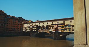 The famouse view of Ponte Vecchio. The view of Ponte Vecchio, the famous Arno river bridge from Uffizi Gallery. Also known as `Old Bridge`, it is one of the stock video footage