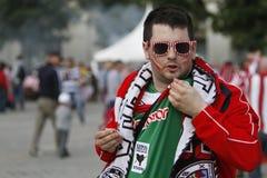 Fanático del fútbol con la cara pintada Foto de archivo libre de regalías