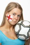 Fanático del fútbol femenino triste con el indicador de Inglaterra en cara Imágenes de archivo libres de regalías