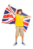 Fanático del fútbol que retiene la bandera inglesa detrás el suyo Imagenes de archivo