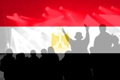 Fanáticos del fútbol con la mezcla de la bandera de Egipto Imagen de archivo libre de regalías