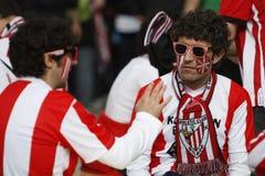 Fanáticos del fútbol con las caras pintadas Imagenes de archivo