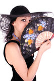 Fan. Young lady with fan and hat Royalty Free Stock Photos