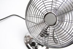 Fan. Metal-styled running fan on a white background Royalty Free Stock Photo