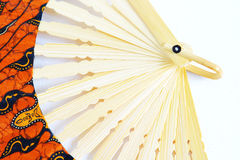 Fan. Open color fan on a white background stock photography