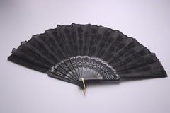 Fan. Black hand fan. Shoot on white background.Open Stock Photo