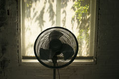 Fan against backlit window Stock Photography