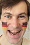 Fan alemana con la cara pintada Imágenes de archivo libres de regalías