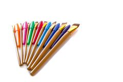 Fan of artist utensils. A fanned display of artist utensils isolated on a white background Royalty Free Stock Photography