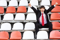 Fan on the audience bleachers Stock Image