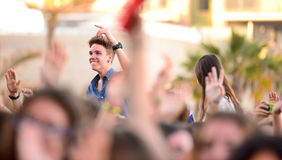 A fan from the audience in a concert at Razzmatazz stage Royalty Free Stock Image