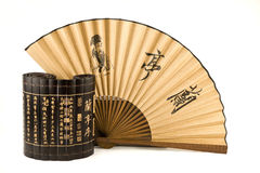 Fan and bamboo Stock Images