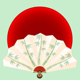 Fan  with bamboo on red circle Stock Photography