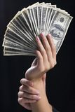 Fan of banknotes. Human hands holding the fan of one hundred banknotes Stock Photo