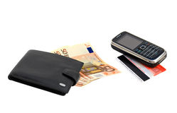 Fan of banknotes of euro and purse. With phone and credit card Stock Photo