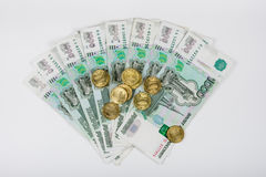 For fan of banknotes one thousandth of Russian rubles is a bunch of ten-Russian coins Royalty Free Stock Photography