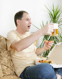 Fan with beer and pizza Royalty Free Stock Images