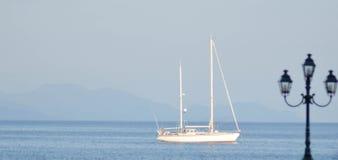 Boat in Garitsa, Bay, Corfu, Greece. Boat offshore in Garitsa Bay, Corfu, Greece Stock Photos