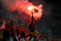 Fan burns flares during the football game Stock Images
