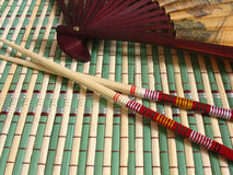 Fan and chopsticks. Japanese fan, bamboo napkin and chopsticks Royalty Free Stock Photos