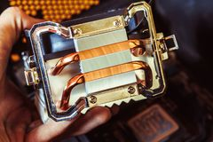 Fan for CPU. CPU cooler, radiator with 2 fans with red blades royalty free stock photo
