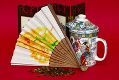 Fan and cup in asian style Stock Image