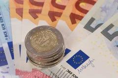 Fan d'argent avec des pièces de monnaie Photographie stock