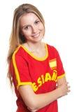 Fan de deportes española derecha con los brazos cruzados Imagenes de archivo