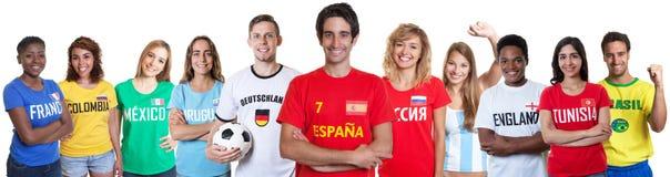 Fan de foot d'Espagne avec des fans d'autres pays images libres de droits