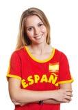 Fan de foot espagnol avec les bras croisés Image libre de droits