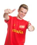 Fan de foot espagnol avec les cheveux blonds montrant les deux pouces Photographie stock libre de droits