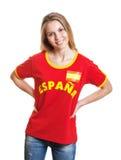 Fan de foot espagnol debout montrant riant de l'appareil-photo Photographie stock libre de droits