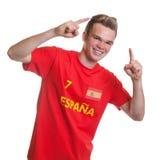 Fan de foot espagnol encourageant avec les cheveux blonds Images stock