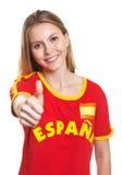 Fan de foot espagnol montrant le pouce à l'appareil-photo Photos stock