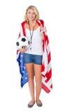 Fan de futebol louro bonito que veste a bandeira dos EUA Imagem de Stock