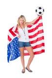 Fan de futebol louro bonito que veste a bandeira dos EUA Imagens de Stock Royalty Free