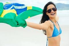 Fan de la mujer de la bandera del Brasil Fotografía de archivo libre de regalías