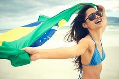 Fan de la mujer de la bandera del Brasil Foto de archivo libre de regalías