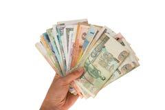 Fan de los billetes de banco de diversos países en la mano fotografía de archivo libre de regalías