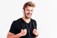 Fan de musique détendez l'homme musculaire sexy de playlist pour écouter musique d'homme de playlist détendent dans des écouteurs photographie stock libre de droits